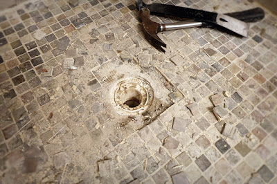 shower leak floor tile drain