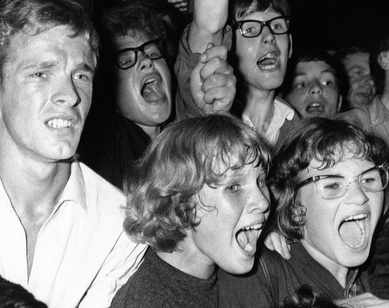 Dutch fans scream and shout during a performance by the Beatles in Blokker, Netherlands, on June 6, 1964.