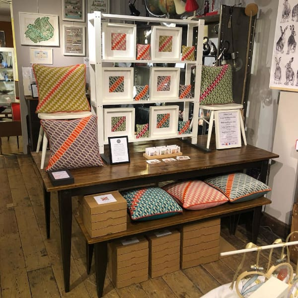 Craft Market Stall displaying needlepoint cushion kits by Marina's Home