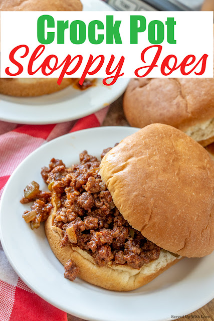 Meaty and saucy sloppy joe on hamburger bun on white plate