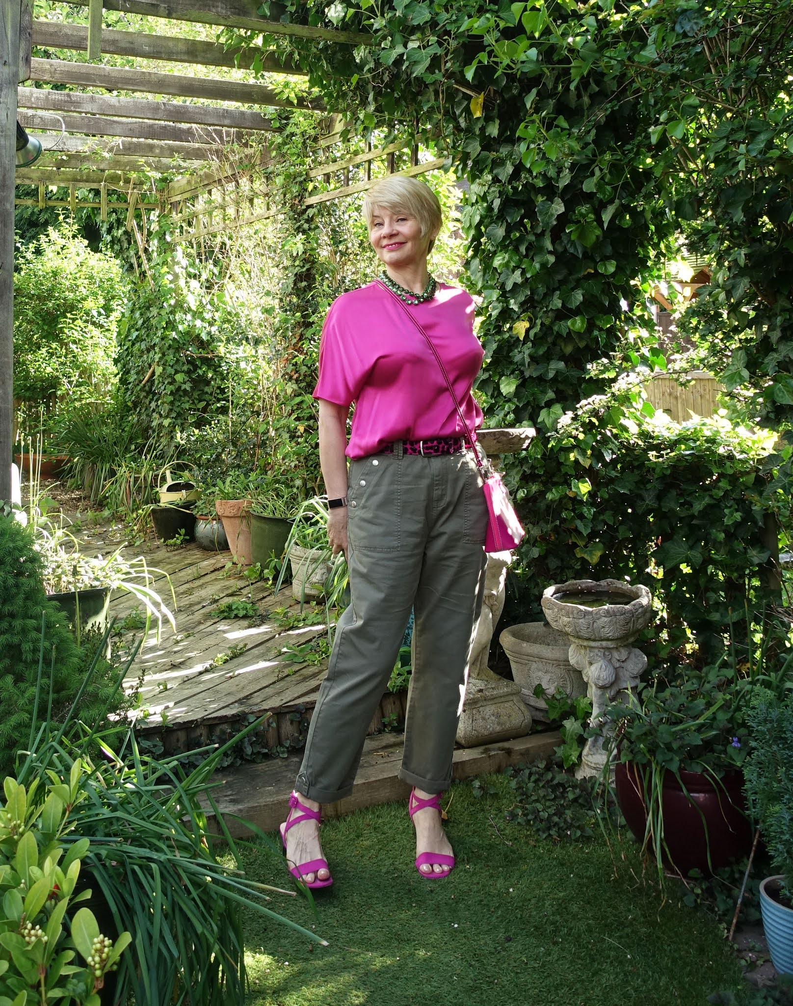 Gail Hanlon from Is This Mutton in khaki cargo trousers and bright pink blouse and sandals