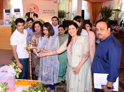Munjal family lighting the lamp during 63rd Founders Day celebration by Hero cycles