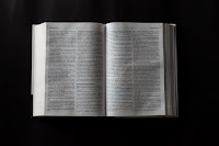 Bible epilogue - Photo by Luis Quintero on Unsplash