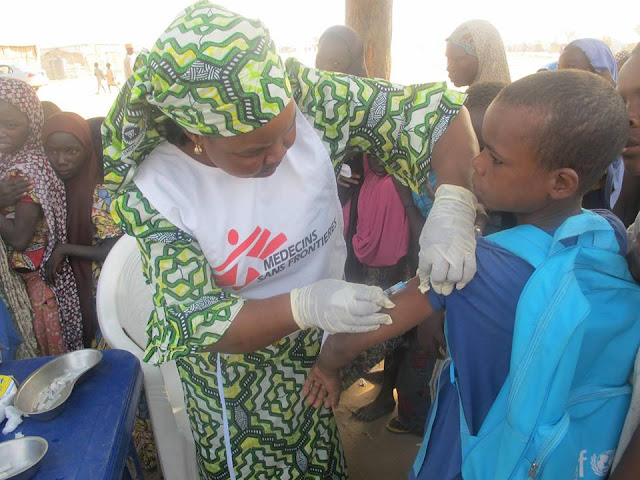 10 year-old Haruna Umar bravely gets his vaccine to protect him from measles
