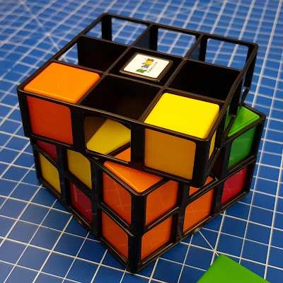 Rubik's Cage with several blocks inserted and several spaces, shows gameplay in progress