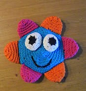 http://www.ravelry.com/patterns/library/crinkle-flower-baby-toy