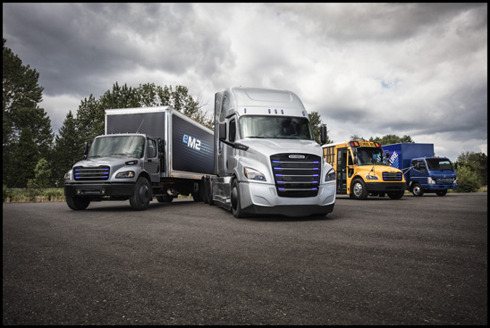 Daimler Trucks' commercial electric vehicle line-up on display (from left to right): Freightliner eM2, Freightliner eCascadia, Thomas Built Buses Saf-T-Liner C2 Jouley, FUSO eCanter