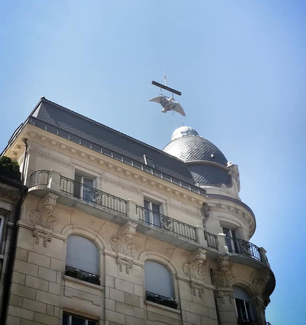 The restored eagle placed on top of the historic Eberhard building