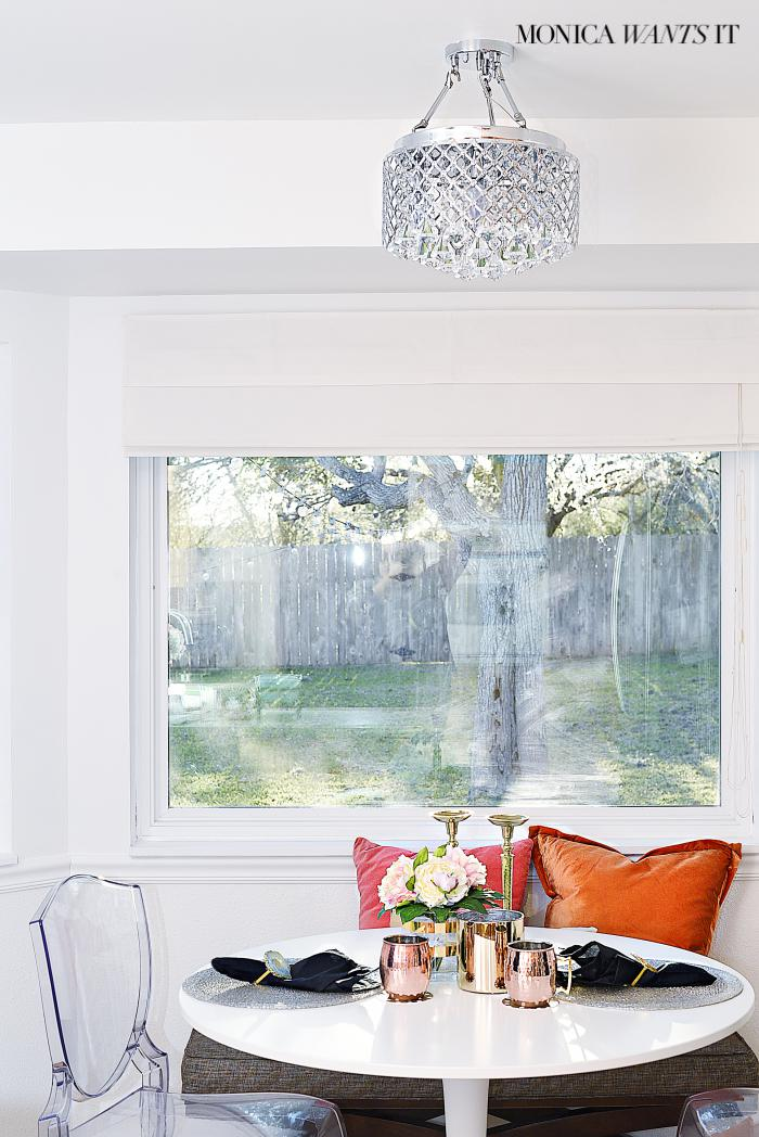 Beautiful breakfast nook makeover with hints of coral, pink, gold and black and white.