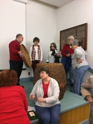 Curator-shows-rye-straw-basket-to-history-class-attendees