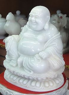 White Burmese jade laughing Buddha sitting