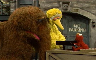 Elmo sings Elmo's Song to Big Bird and Snuffy. Sesame Street The Best of Elmo