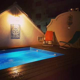 Swimming pool on terrace with lighting