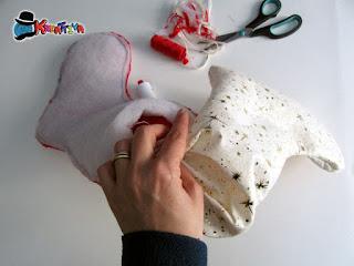 rivoltamento della calza natalizia per scoprire finalmente il risultato finale