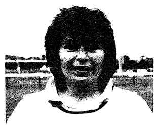 A black and white image of a smiling woman's face