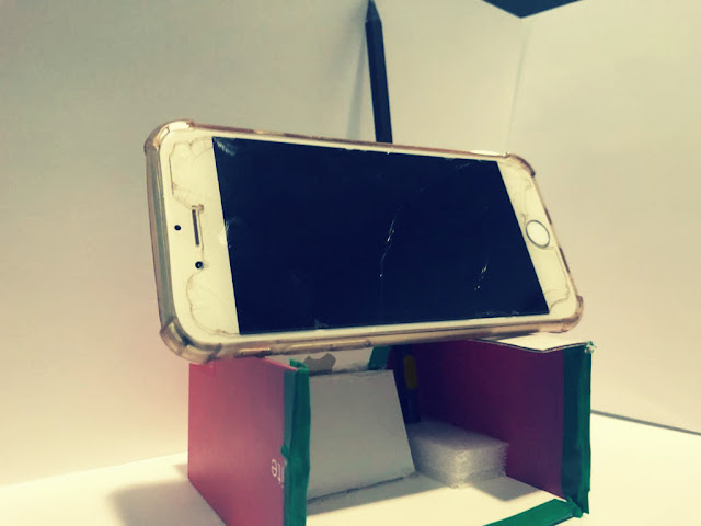 An affordable custom phone stand with a pen holder for quick reach and writing notes