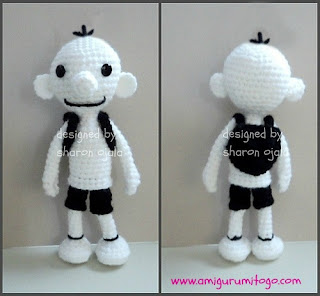 white crochet doll with black packsack