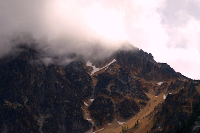 fog rolling over a mountain in north cascades national park