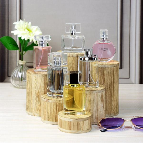 The Wooden 6 Pcs Round Risers Display can showcase bottles of perfume | NileCorp.com