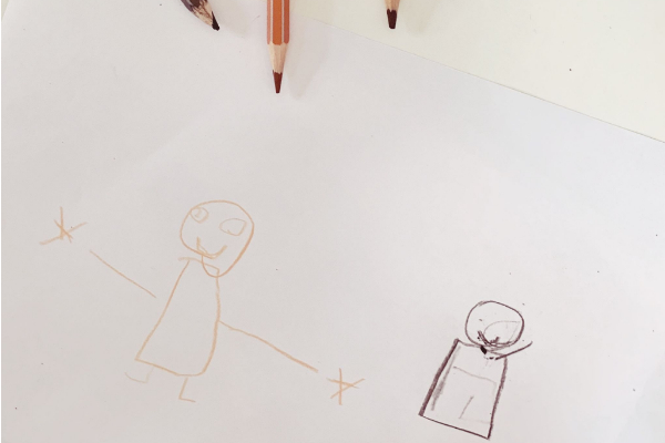 child drawing of a white skin and black skin person