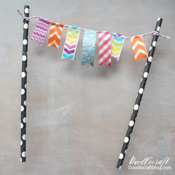 Make a darling cake topper using paper straws with washi tape and bakers twine.