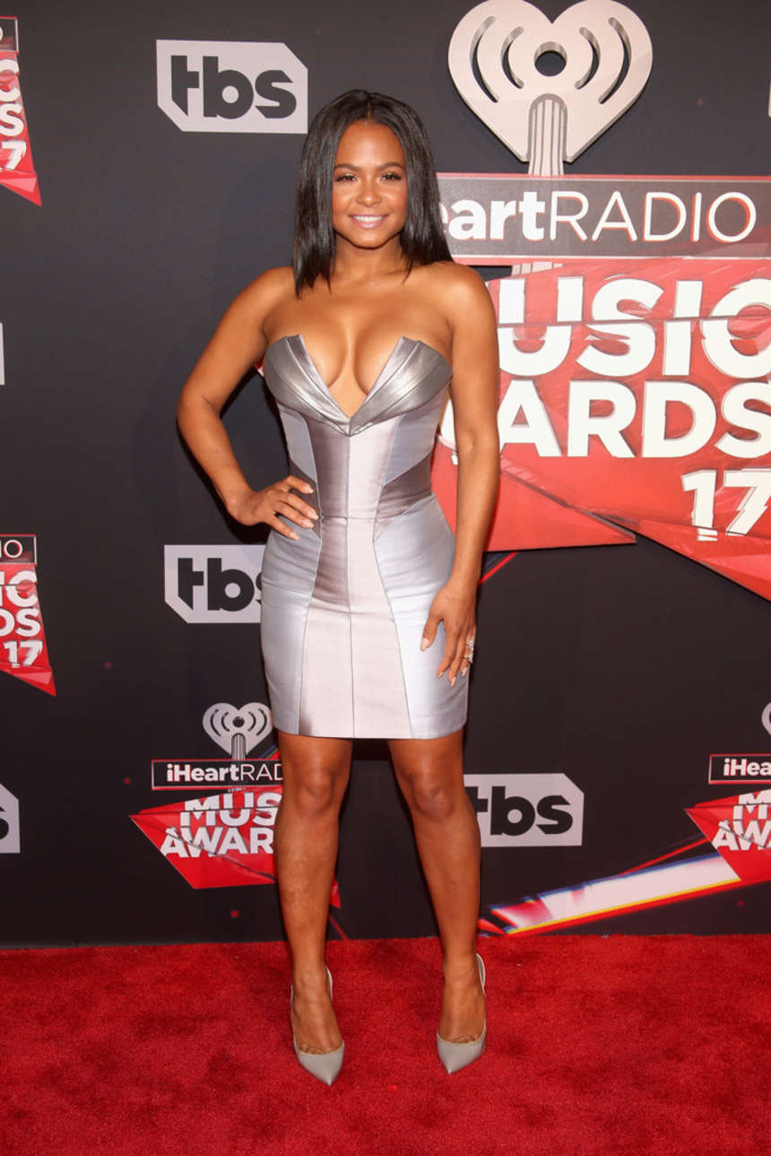 Christina Milian puts ample bosom on show at the 2017 iHeartRadio Music Awards in LA