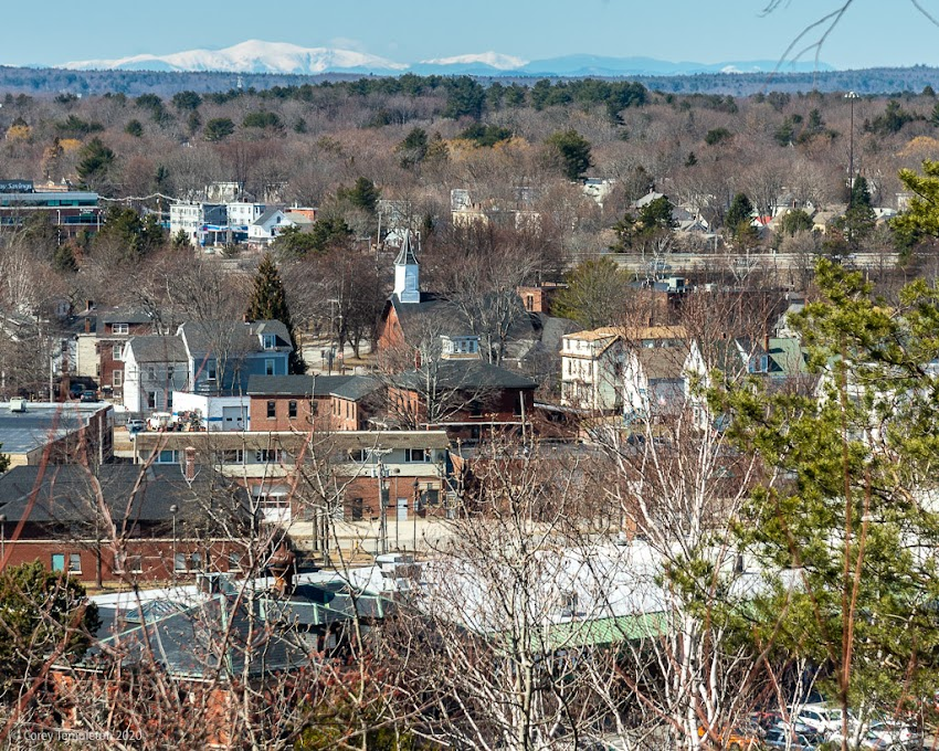 Portland, Maine USA March 2020 photo by Corey Templeton. A glimpse of a snow-capped Mt. Washington, about 66 miles away from the Western Promenade.