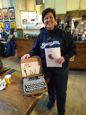 Reporter Meg Jones with Skyriter typewriter