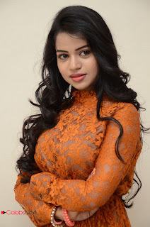 Bhavya Sri looks super cute in Orange Transparent Lace Gown at Kali Movie Audio Launch