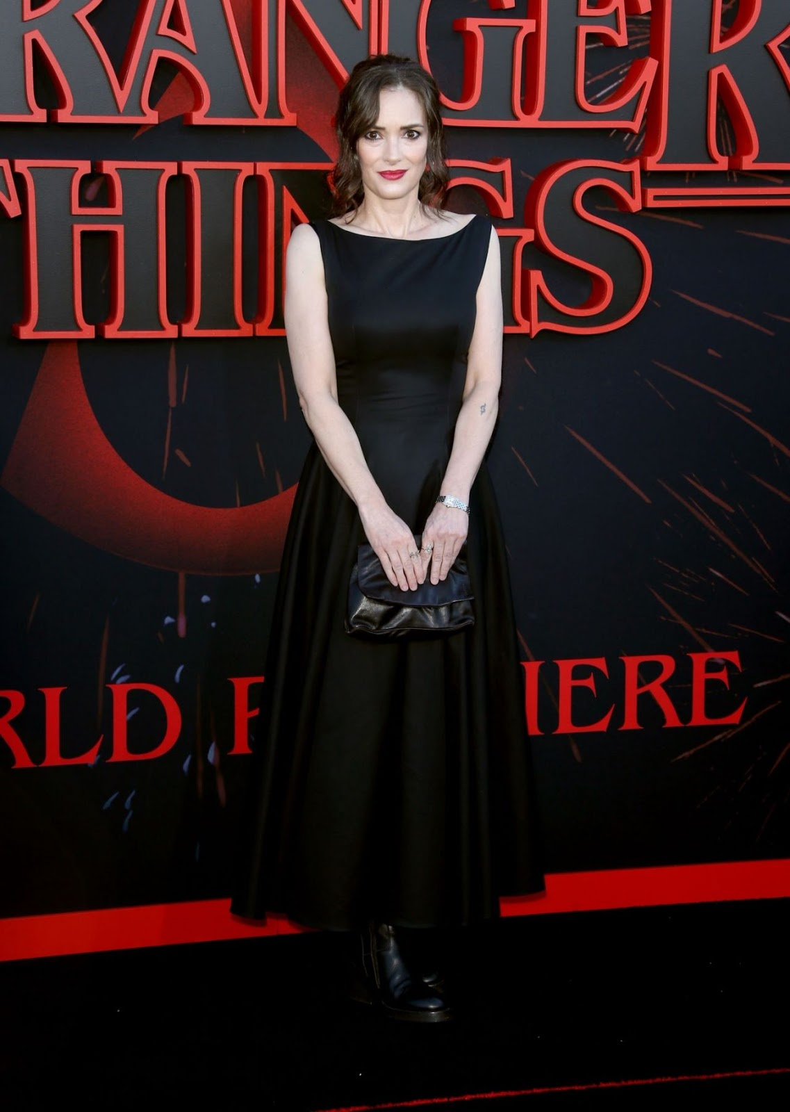 Winona Ryder cuts a sophisticated chic figure in elegant black dress at Stranger Things 3 premiere in Los Angeles