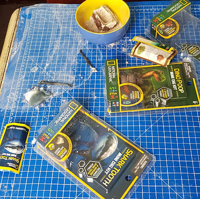 National Geographic Mini Dig Kits being used by children mess on table