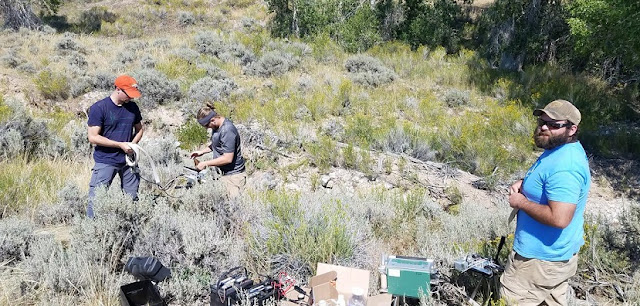 UW researchers Daniel Beverly, Mario Bretfeld and Adam Nibbelink set up devices in sagebrush at a site 50 miles south of Yellowstone National Park to measure sagebrush response to the total solar eclipse in August 2017. (Krag Beverly Photo)