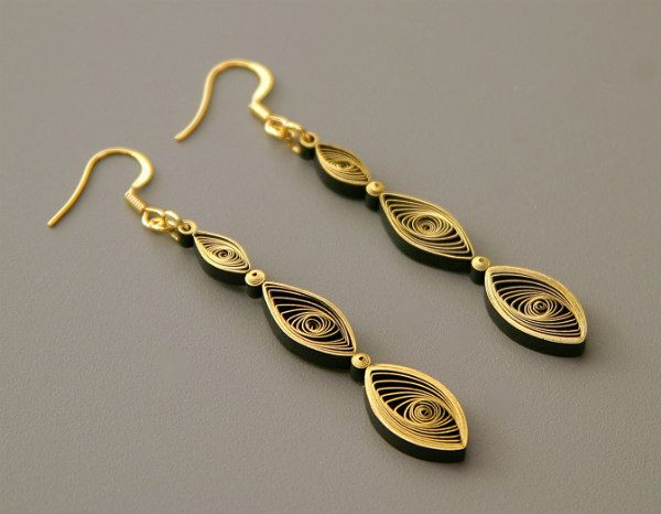 pair of gilded quilled drop earrings made with marquise vortex coils and tight coils
