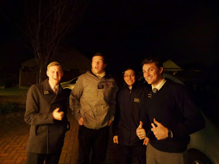 Missionaries from The Church of Jesus Christ of Latter Day Saints carolling together