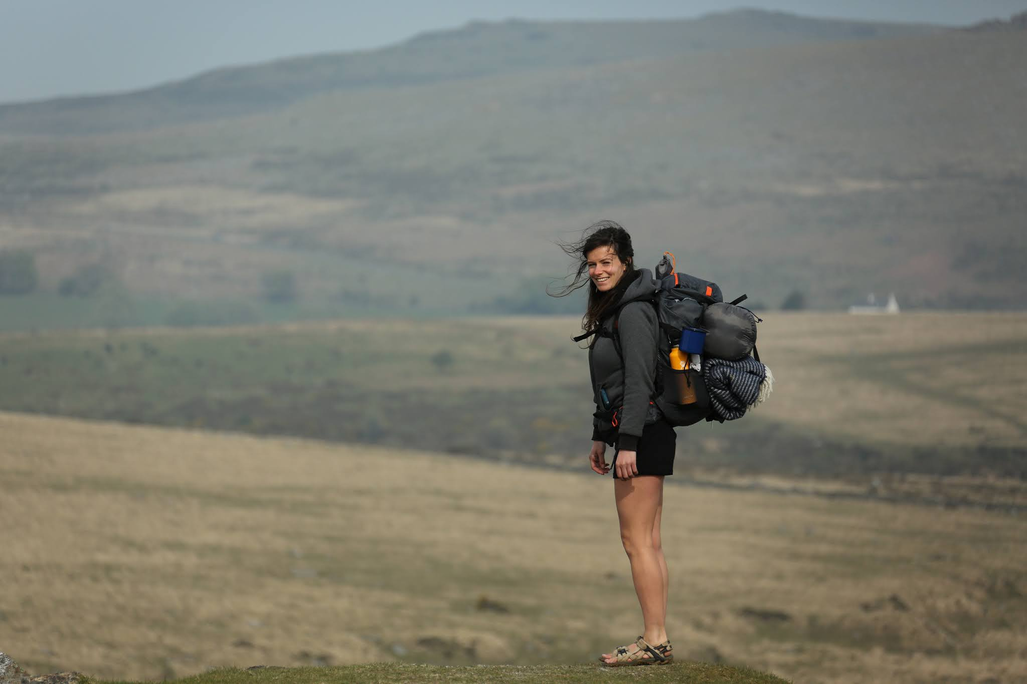 Hiking girl stood on a hill in Dartmoor
