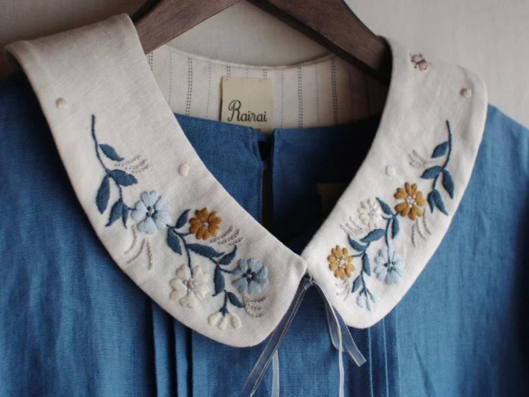 Hình thêu hoa trên cổ áo