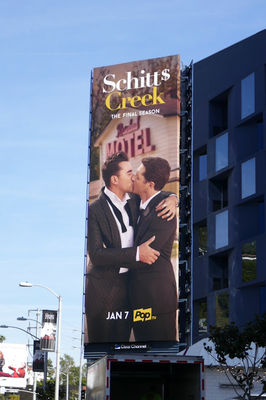 Schitts Creek season 6 gay kiss billboard
