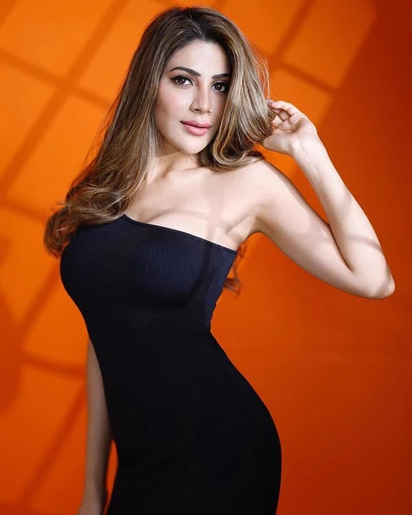 Nikki Tamboli shows off her sexy body in a body hugging one shoulder dress.