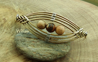 Pipa wrapped with picture jasper (matte) for bracelet resting on a stone