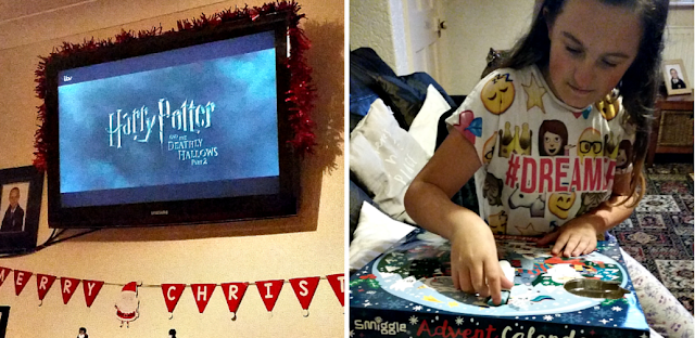 Harry Potter on the TV and my youngest opening her advent calendar