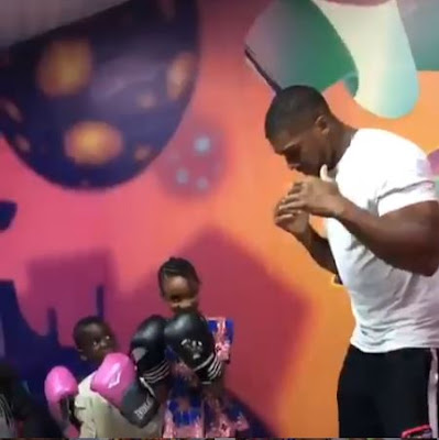 Anthony Joshua With Uriel Oputa As He Hangs Out With The Children Of Makoko Community, Lagos