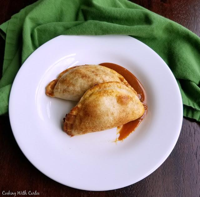two cajeta and apple empanadas on plate
