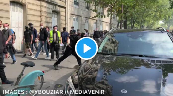 VIDÉO -  Gilets jaunes  à Paris : Poussé au sol pour avoir tenté d'arrêter un homme cagoulé de dégrader une voiture