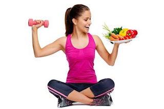 Fit woman sitting holding a barbell and food