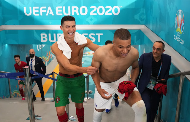 Cristiano Ronaldo and Kylian Mbappe all smiles