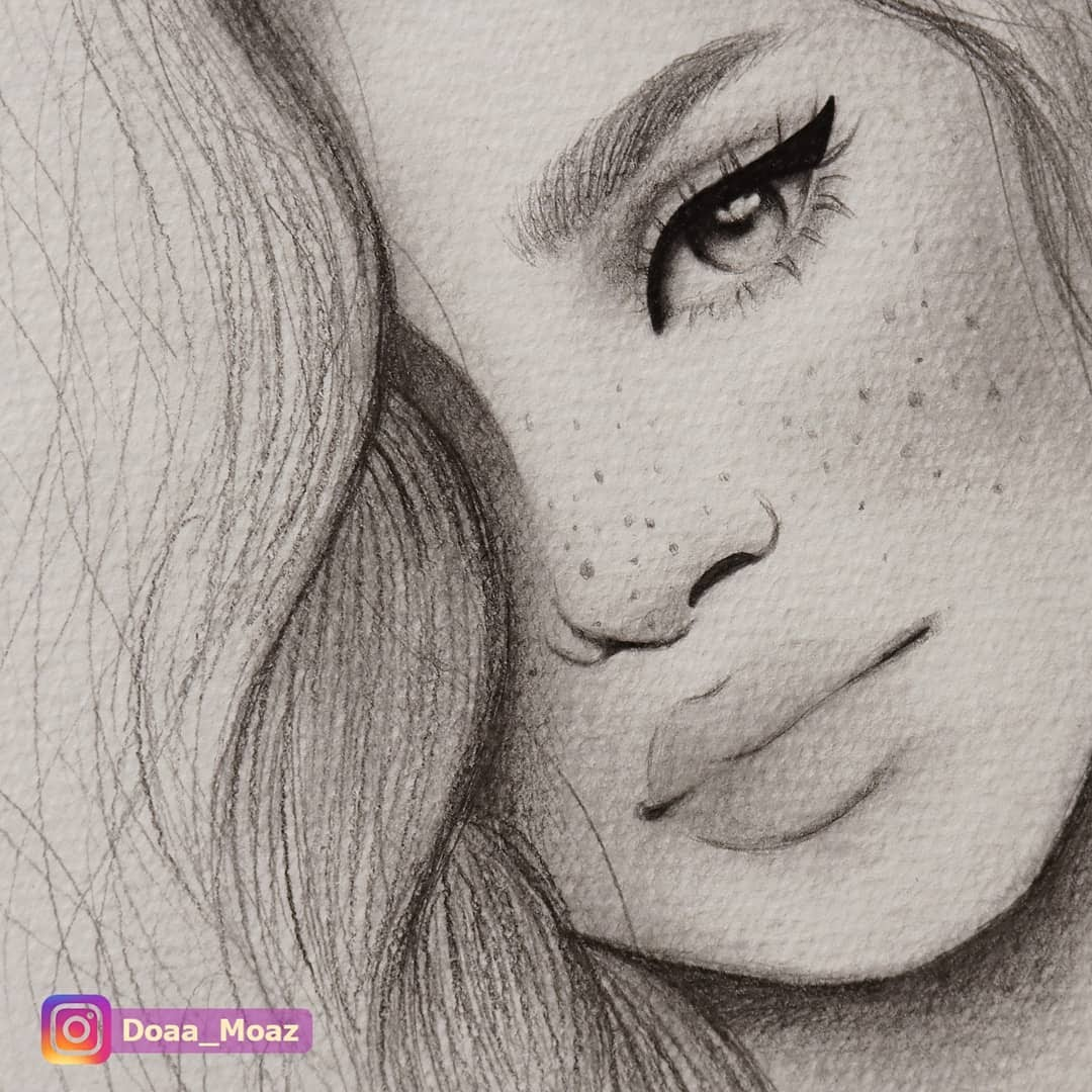 13-Doaa-Moaz-Female-Portrait-Drawings-www-designstack-co