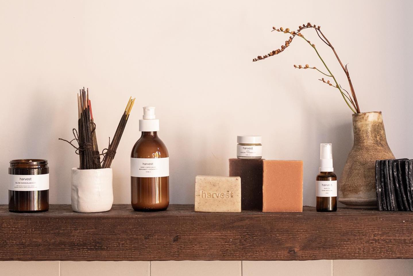 A selection of bottles and jars filled with beauty products from Harvest skincare