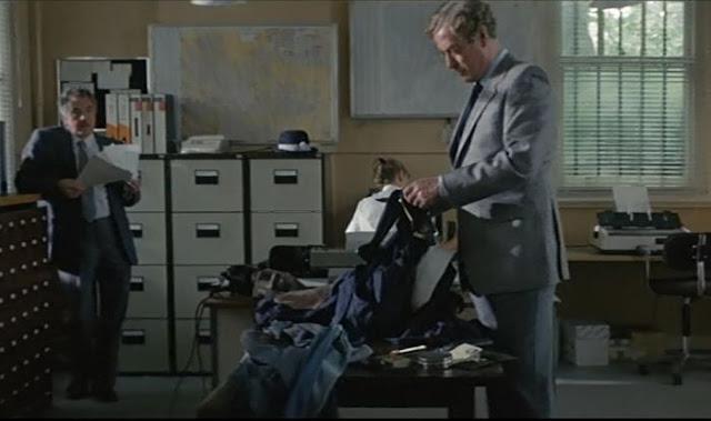 Michael Caine going through a dead man's effects