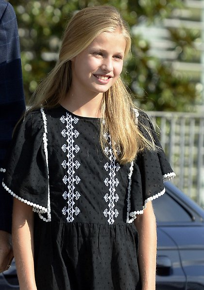 Queen Letizia wore Mango print trousers. Princess Leonor wore an embroidered dress by Mango. Sofia wore an embroidered dress by Mango