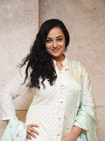 Nithya Menon Gorgeous looking photos gallery-cover-photo